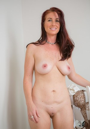 a hot girl holding her boobs